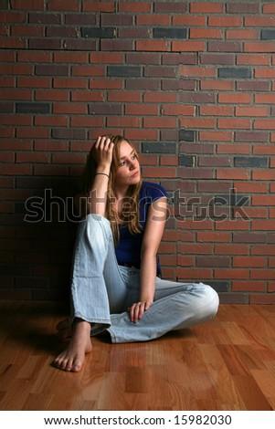 casual woman sitting on floor - stock photo