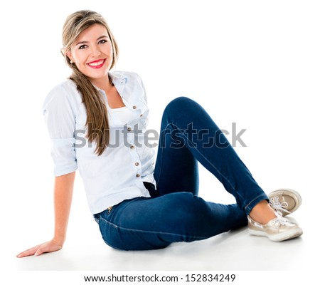 Casual woman sitting on the floor smiling - isolated over a white background  - stock photo
