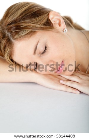 casual woman sleeping and leaning on her hands isolated over a white background