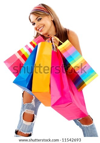 Casual woman smiling and carrying shopping bags isolated over a white background - stock photo