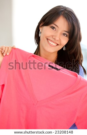 Casual woman smiling and shopping clothes in a store - stock photo