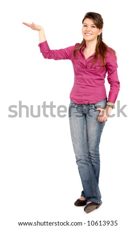 casual woman smiling displaying something isolated over a white background