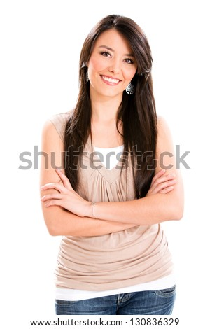 Casual woman smiling with arms crossed - isolated over white - stock photo