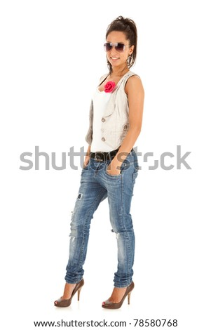 casual woman standing and smiling isolated over a white background - stock photo