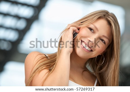 Casual woman talking on the phone and smiling