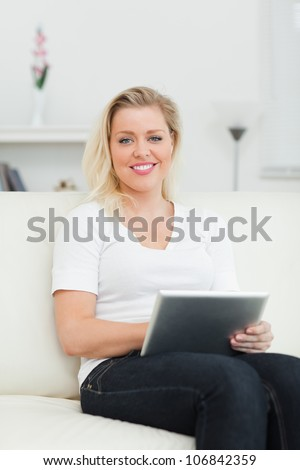 Casual woman using a notebook in a living room