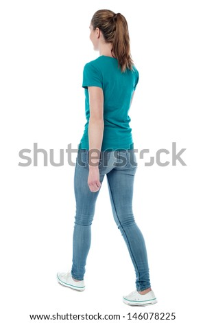A Boy Walking Away From A Girl Casual woman walking away from the camera - stock photo