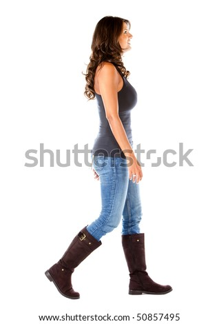 Casual woman walking isolated over a white background