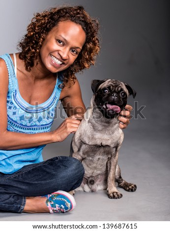Casual woman with a cute dog looking happy - stock photo