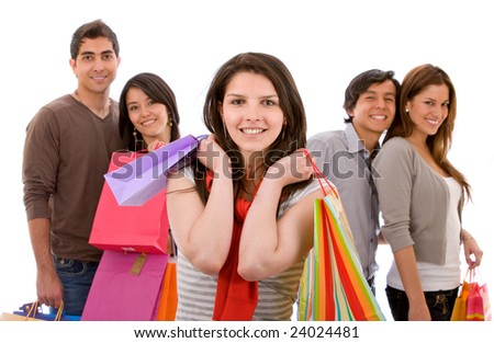 Casual woman with shopping bags and some people behind her - isolated on white - stock photo