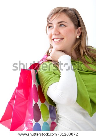Casual woman with shopping bags isolated on white - stock photo