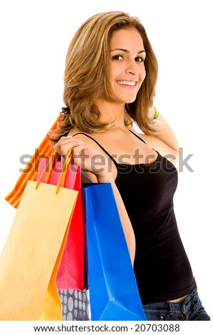 Casual woman with shopping bags smiling and isolated on white - stock photo