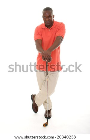Casual young African American man in a bright orange golf shirt holding a golf club. - stock photo