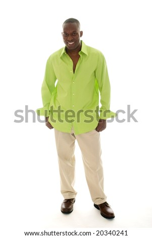 Casual young African American man standing in a bright green shirt. - stock photo