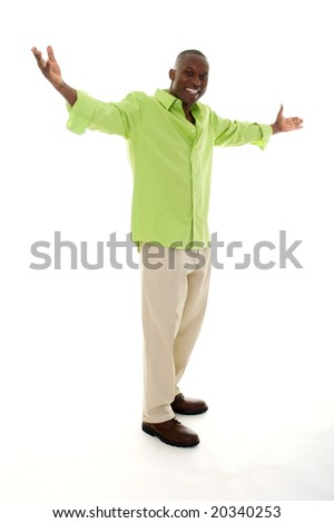 Casual young African American man standing in a bright green shirt with a welcoming hands apart gesture.
