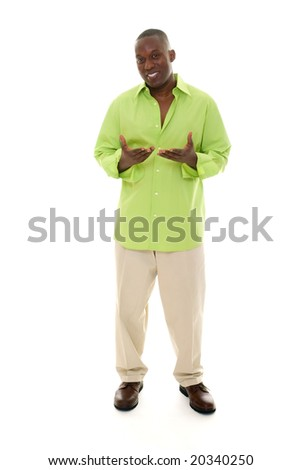 Casual young African American man standing in a bright green shirt with hands gesturing inward. - stock photo