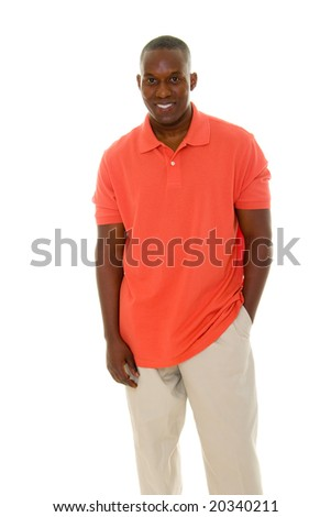 Casual young African American man standing in an orange golf shirt.