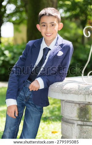 casual young boy with tie smiling - stock photo