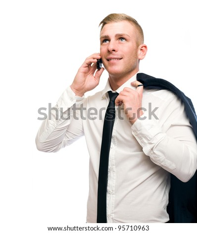 Casual young businessman talking on cellphone isolated on white background.