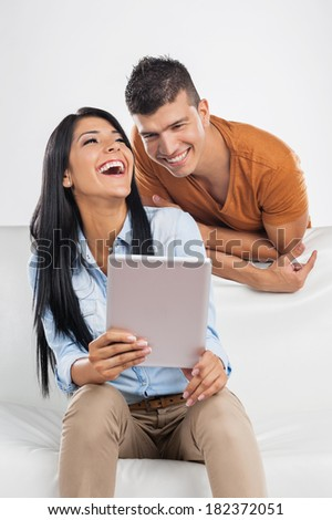 Casual young couple with tablet - stock photo
