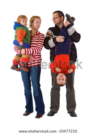 Casual young family with two kids - isolated - stock photo