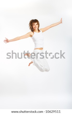 Casual young girl isolated over white background in high key setup