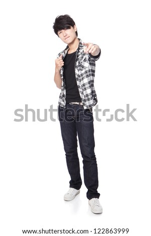 Casual young man finger point to you in full body isolated on white background, asian model