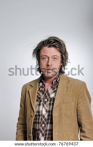 Casual young man half long blond hair. Studio portrait. - stock photo