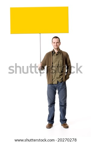 Casual young man holding a placard / sign, looking straight on - stock photo