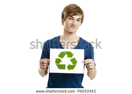 Casual young man holding a recycling sign to promote a green and better world, isolated on white background - stock photo
