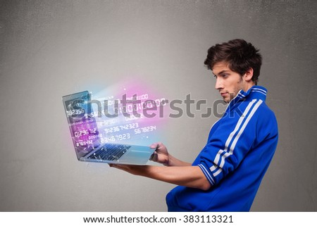 Casual young man holding laptop with exploding data and numbers - stock photo