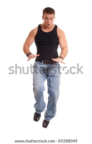 Casual young man in black undershirt and jeans. - stock photo