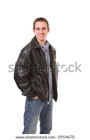 casual young man in blue jeans and leather jacket