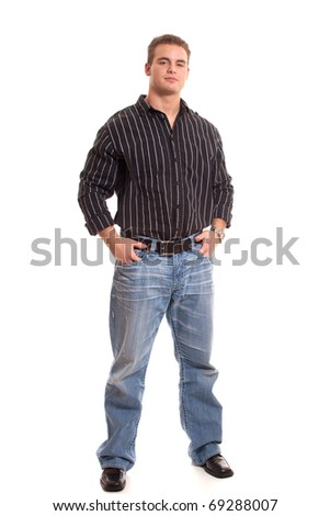 Casual young man in dress shirt and jeans. - stock photo
