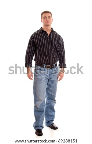 Casual young man in dress shirt and jeans.