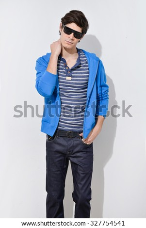 Casual young man in jeans - stock photo