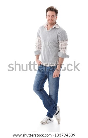 Casual young man in jeans and shirt smiling. - stock photo