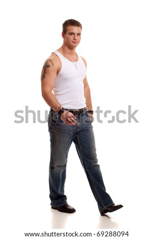 Casual young man in white undershirt and jeans. - stock photo