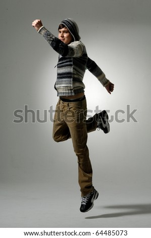 casual young man jumping in light background