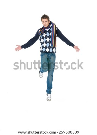 casual young man jumping on white background - stock photo