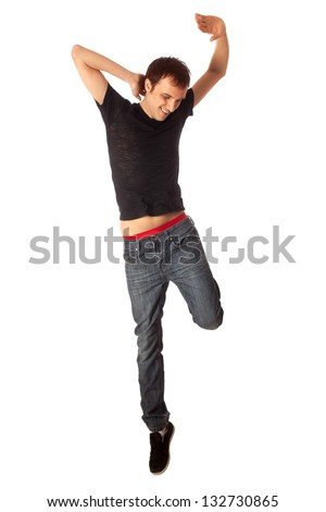 Casual young man jumping. Studio shot over white.