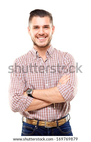 Casual young man looking at camera with arms crossed and satisfaction  - stock photo