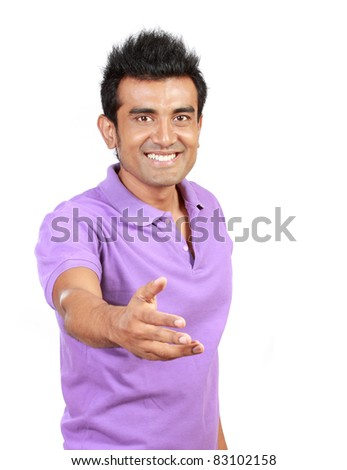 Casual Young Man Offering A Handshake - stock photo