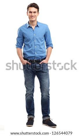 Casual young man standing - stock photo