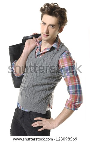 Casual young man standing with bag - isolated over a white background