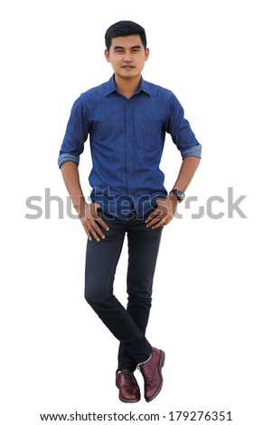 casual young man standing with his arm crossed over white background - stock photo
