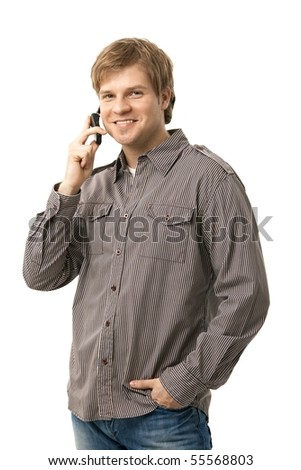 Casual young man talking on mobile phone, smiling. Isolated on white. - stock photo