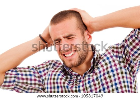 Casual young man with a headache on a white background - stock photo