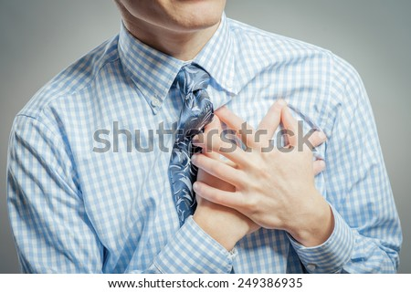 Casual young man with chest pain  - stock photo