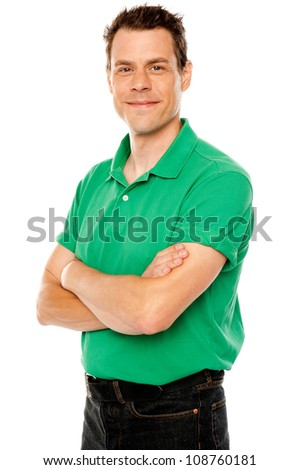 Casual young man with crossed arms isolated over white - stock photo